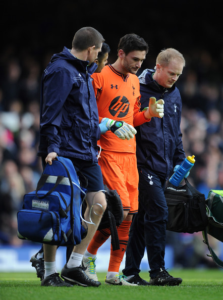 Hugo Lloris of Tottenham Hotspur leaves the field through injury during the Barclays Premier League match between Everton and Tottenham Hotspur at Goodison Park on November 03, 2013 in Liverpool, England.