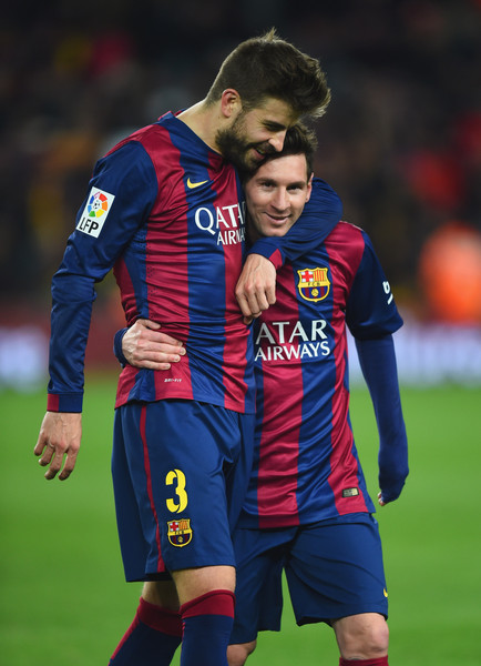 Gerard Pique and Lionel Messi of Barcelona celebrate victory after the La Liga match between FC Barcelona and Real Madrid CF at Camp Nou on March 22, 2015 in Barcelona, Spain.