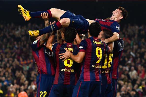 Lionel Messi of FC Barcelona celebrates with his teammates after scoring his team's fourth goal during the La Liga match between FC Barcelona and Sevilla FC at Camp Nou on November 22, 2014 in Barcelona, Spain. Lionel Messi beat the  number of goal in the Spanish La Liga of Telmo Zarra scoring his 252nd goal.