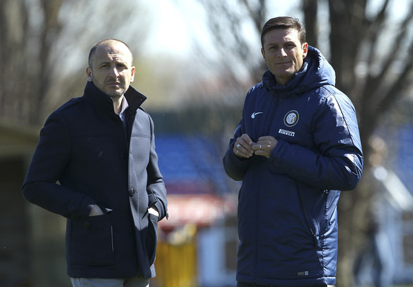 Sporting Director of FC Internazionale Milano Piero Ausilio (L) and Vice President of FC Internazionale Milano Javier Zanetti (R) look on during a FC Internazionale training session at the club's training ground on April 7, 2015 in Appiano Gentile Como, Italy.