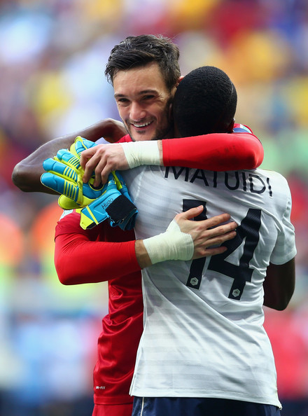 Goalkeeper Hugo Lloris (L) and Blaise Matuidi of France celebrate after defeating Nigeria 2-0 during the 2014 FIFA World Cup Brazil Round of 16 match between France and Nigeria at Estadio Nacional on June 30, 2014 in Brasilia, Brazil.
