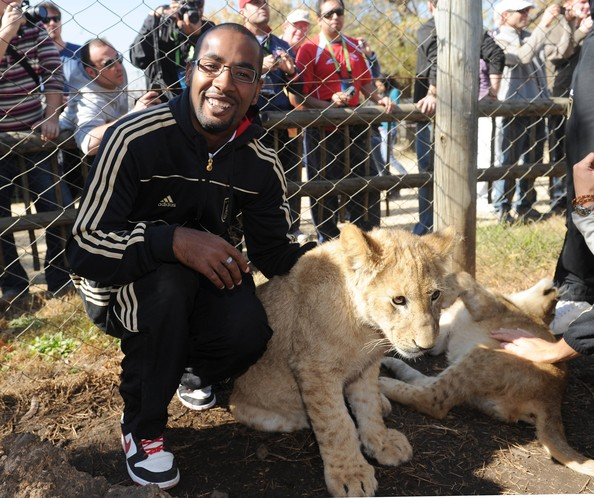 Cacau Cacau of the German National Team strokes a lion cup during a visit at the Lion Park on June 25, 2010 in Lanseria, South Africa.