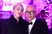 Recording artist Miley Cyrus (L) and James Gager, Senior Vice President and Group Creative Director, MAC Cosmetics, attend the 23rd Annual Elton John AIDS Foundation Academy Awards Viewing Party on February 22, 2015 in Los Angeles, California.