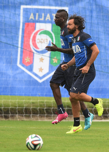 Mario Balotelli and Andrea Pirlo (R) of Italy during a training session on June 10, 2014 in Rio de Janeiro, Brazil.