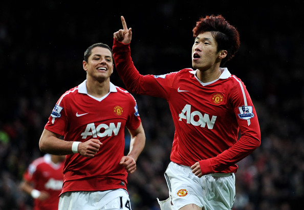 Ji-Sung Park Ji-Sung Park of Manchester United celebrates scoring the opening goal with team mate Javier Hernandez (L) during the Barclays Premier League match between Manchester United and Wolverhampton Wanderers at Old Trafford on November 6, 2010 in Manchester, England.