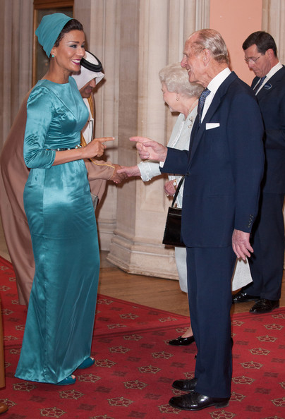 Sheika Mozah bint Nasser Al-Missned of Qatar is greeted by Queen Elizabeth II and Prince Phillip, Duke of Edinburgh at a lunch For Sovereign Monarchs in honour of Queen Elizabeth II's Diamond Jubilee, at Windsor Castle, on May 18, 2012 in Windsor, England.