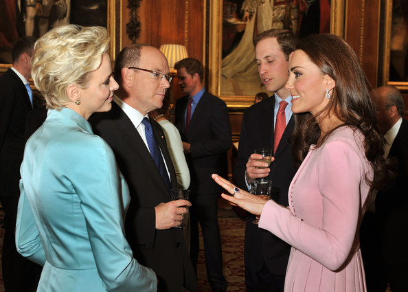Catherine, Duchess of Cambridge talks to Princess Charlene of Monaco as Prince Albert II of Monaco and Prince William, Duke of Cambridge look on during a reception in the Waterloo Chamber, before the Lunch For Sovereign Monarchs at Windsor Castle, on May 18, 2012 in Windsor, England.