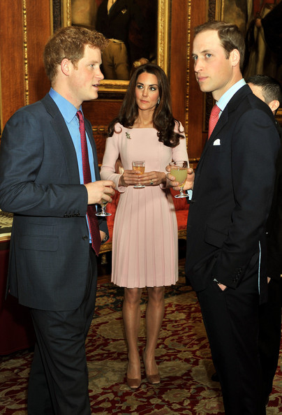 Catherine, Duchess of Cambridge and Prince William, Duke of Cambridge speak to Prince Harry during a reception in the Waterloo Chamber, before the Lunch For Sovereign Monarchs at Windsor Castle, on May 18, 2012 in Windsor, England.