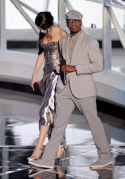Actress Selena Gomez (L) and singer Ne-Yo speak onstage during the 2010 MTV