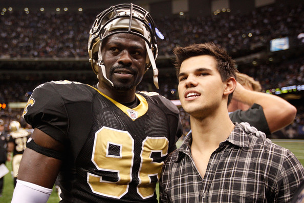 Taylor Lautner Actor Taylor Lautner talks with Alex Brown #96 of the New Orleans Saints during the game against the St. Louis Rams at the Louisiana Superdome on December 12, 2010 in New Orleans, Louisiana.