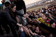 In this handout image provided by UNHCR, UNHCR Special Envoy Angelina Jolie meets members of the Yazidi minority in Khanke IDP Camp on January 25, 2015 in Khanke, Iraq. Angelina Jolie was visiting Syrian refugees and displaced Iraqi citizens in the Kurdistan Region of Iraq to offer support to 3.3 million displaced people in the country and highlight their dire needs.