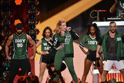 Iggy Azalea (C) performs onstage during iHeartRadio Jingle Ball 2014, hosted by Z100 New York and presented by Goldfish Puffs at Madison Square Garden on December 12, 2014 in New York City.