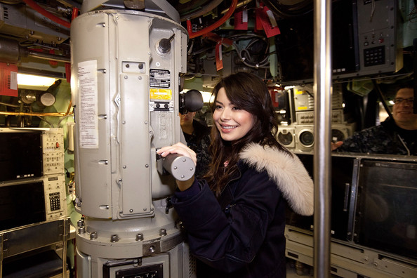 Actress Miranda Cosgrove uses the perisciope on-board the submarine USS Hartford at Naval Submarine Base New London on January 11, 2012 in Groton, Connecticut. Cosgrove and the cast of iCarly were presenting a special military family screening of iMeet The First Lady, an episode of their show featuring Michelle Obama.
