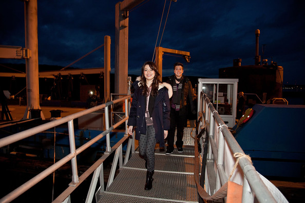 Miranda Cosgrove and Noah Munck board the submarine USS Hartford at Naval Submarine Base New London on January 11, 2012 in Groton, Connecticut. Cosgrove and the cast of iCarly were presenting a special military family screening of iMeet The First Lady, an episode of their show featuring Michelle Obama.