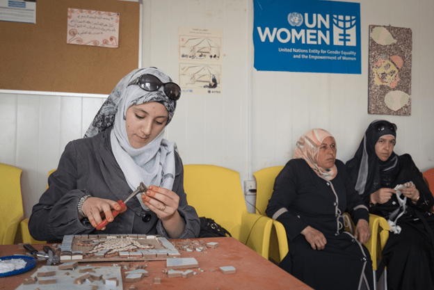 Alaa in a mosaic workshop in UN Women's women center (Oasis) in Zaatri Refugee Camp. Photo: UN Women/ Christopher Herwig