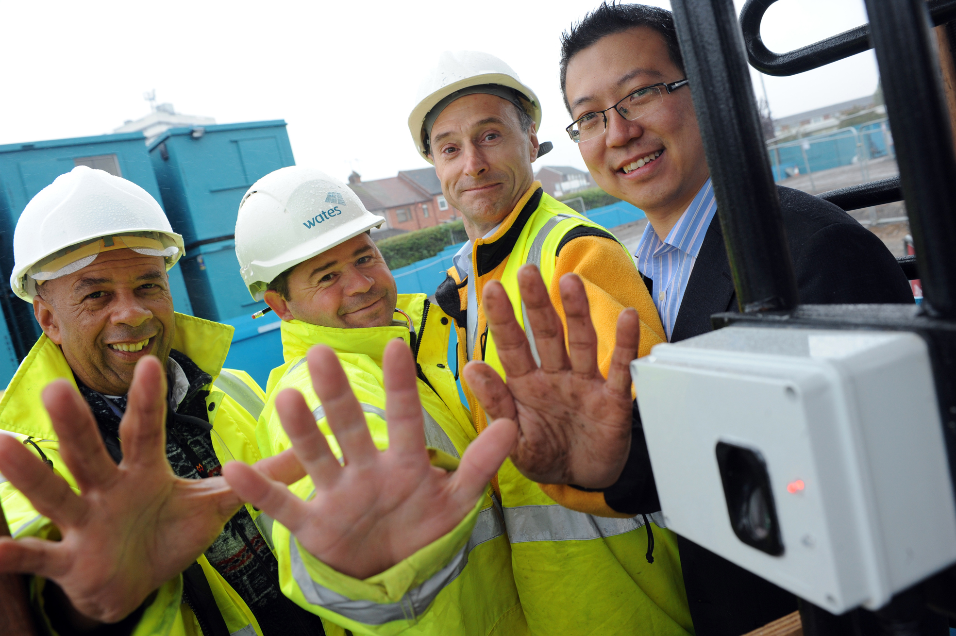 Robert Senior (Site Engineer), Phil Bardsley (Section manager) and Rodney Holland (Managing Director of the equipment's Installation Company - DCS) and Dr Li Wang on far right - builders showing abraded fingerprints, and BioLog equipment in use on a Coventry building site