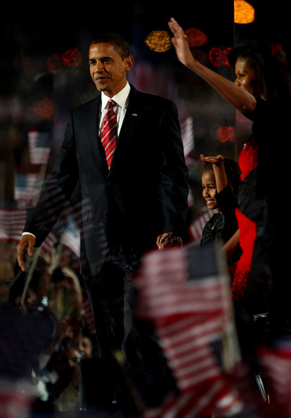 Barack Obama U.S. President elect Barack Obama (L) walks on stage with his wife Michelle (R) and daughters Malia and Sasha to address his supports during an election night gathering in Grant Park on November 4, 2008 in Chicago, Illinois. Obama defeated Republican nominee Sen. John McCain (R-AZ) by a wide margin in the election to become the first African-American U.S. President elect.