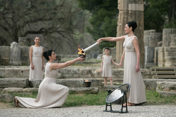 The ceremonial lighting of the Olympic Flame