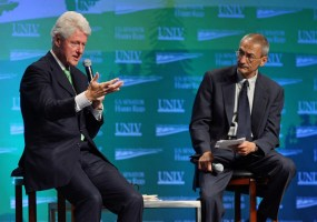 John Podesta Former U.S. President Bill Clinton (L) and President and CEO of the Center for American Progress Action Fund John Podesta, speak during the opening session of the National Clean Energy Summit at the Cox Pavilion at UNLV August 18, 2008 in Las Vegas, Nevada. Political and economic leaders are attending the two-day summit to discuss alternative energy options for the country's future.