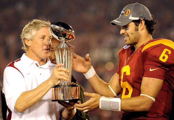Pete Carroll hands Mark Sanchez trophy after the Junior Quarterback threw for 413 yards and 4 TDs