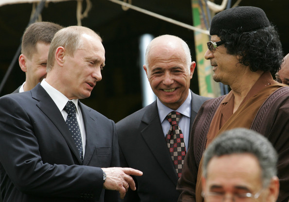 Russian President Vladimir Putin (L) stands next to Libyan leader Muammar Qadaffi (R) during the signing of agreements between the two countries April 17, 2008 in Tripoli, Libya. Putin is in Libya for a two-day official visit to rebuild Russian-Libyan relations.