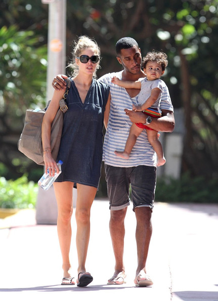 Sunnery James Victoria's Secret model Doutzen Kroes shows her affection to her husband DJ Sunnery James and her son Phyllon Joy Gorré (b. January 21, 2011) as they take a family walk together on a sunny day in Miami Beach.