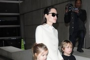 Actress Angelina Jolie arriving on a flight at LAX airport in Los Angeles, California with her children Vivienne & Knox on February 11, 2015. Angelina is returning from London where she had a meeting with Conservative politician and friend William Hague.