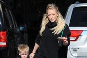 Actress Hilary Duff and son Luca Comrie stop by Starbucks for an iced coffee in Studio City, California on January 31, 2015. Luca was still rocking his green pajamas and didn't look to happy to be out instead of sleeping in his bed.