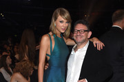 Recording artist Taylor Swift (L) and UMG Worldwide CEO Lucian Grainge attend The 57th Annual GRAMMY Awards at the STAPLES Center on February 8, 2015 in Los Angeles, California.
