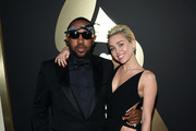 Music Producer Mike Will Made It and recording artist Miley Cyrus attend The 57th Annual GRAMMY Awards at the STAPLES Center on February 8, 2015 in Los Angeles, California.
