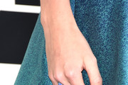 Singer Taylor Swift (jewelry detail) attends The 57th Annual GRAMMY Awards at the STAPLES Center on February 8, 2015 in Los Angeles, California.