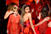 Barbara Eden (L) and Zendaya walk the runway at the Go Red For Women Red Dress Collection 2015 presented by Macy's fashion show during Mercedes-Benz Fashion Week Fall 2015 at The Theatre at Lincoln Center on February 12, 2015 in New York City.