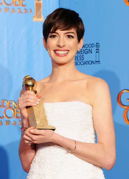 "Anne Hathaway Actress Anne Hathaway, winner of Best Supporting Actor in a Motion Picture for ""Les Miserables,"" poses in the press room during the 70th Annual Golden Globe Awards held at The Beverly Hilton Hotel on January 13, 2013 in Beverly Hills, California."