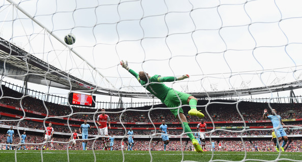 Joe Hart of Manchester city is beaten by Alexis Sanchez of Arsenal (Not in Picture) during the Barclays Premier League match between Arsenal and Manchester City at Emirates Stadium on September 13, 2014 in London, England.