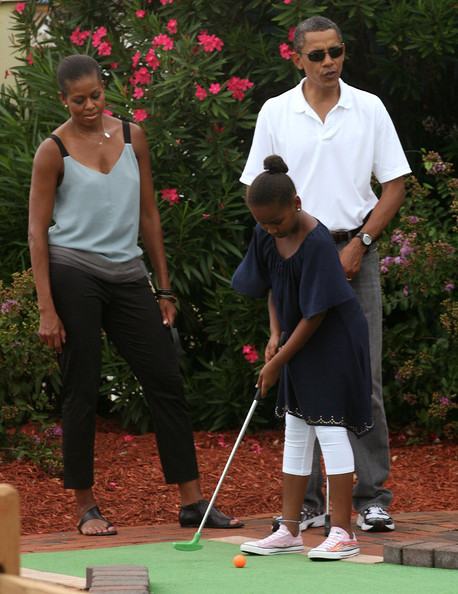 Barack Obama (AFP OUT) United States President Barack Obama and first lady Michelle Obama play miniature golf with daughter Sasha at Pirate's Island Miniature Golf August 14, 2010 in Panama City Beach, Florida. The First Family is visiting the area to help promote tourism and check up on cleanup efforts from the aftermath of the Deepwater Horizon Oil spill.