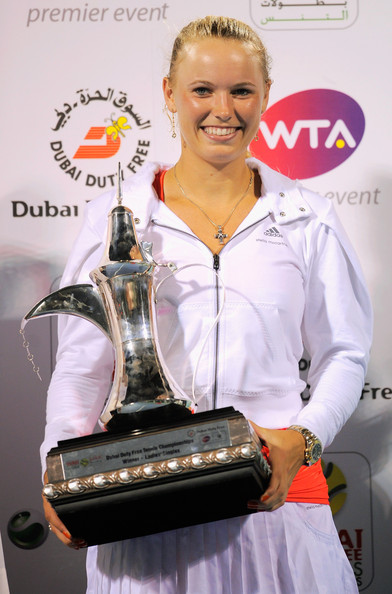 Caroline Wozniacki Caroline Wozniacki of Denmark poses with the trophy after beating Svetlana Kuznetsova of Russia and winning the final of the Dubai Duty Free Tennis Championship at the Dubai Tennis Stadium on February 20, 2011 in Dubai, United Arab Emirates.