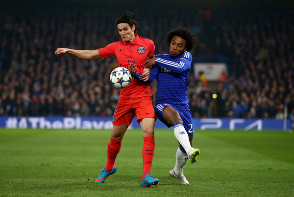 Edinson Cavani of PSG and Willian of Chelsea battle for the ball during the UEFA Champions League Round of 16, second leg match between Chelsea and Paris Saint-Germain at Stamford Bridge on March 11, 2015 in London, England.