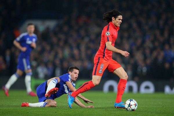 Edinson Cavani of PSG goes past Cesar Azpilicueta of Chelsea during the UEFA Champions League Round of 16, second leg match between Chelsea and Paris Saint-Germain at Stamford Bridge on March 11, 2015 in London, England.