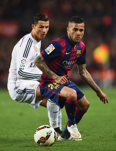 Daniel Alves of Barcelona evades Cristiano Ronaldo of Real Madrid CF during the La Liga match between FC Barcelona and Real Madrid CF at Camp Nou on March 22, 2015 in Barcelona, Spain.