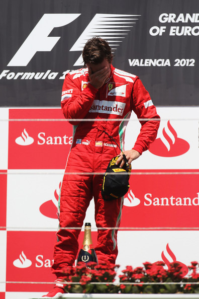 Fernando Alonso Fernando Alonso of Spain and Ferrari reacts on the podium after winning the European Grand Prix at the Valencia Street Circuit on June 24, 2012 in Valencia, Spain.