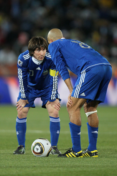Lionel Messi and Juan Veron of Argentina plan a free kick during  the 2010 FIFA World Cup South Africa Group B match between Greece and  Argentina at Peter Mokaba Stadium on June 22, 2010 in Polokwane, South  Africa.