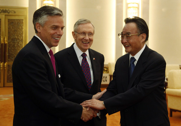 Jon Huntsman U.S.Senator Harry Reid, Democrat from Nevada, at center looks on as U.S. ambassador to China, Jon Huntsman, at left shakes hand with Wu Bangguo, Chairman of the Standing Committee of the National People's Congress at the Great Hall of the People on April 21, 2011 in Beijing, China.   Majority Leader Harry Reid leads an unusually large delegation of 9 other U.S. senators for talks with Chinese officials on topics from clean energy to human rights.
