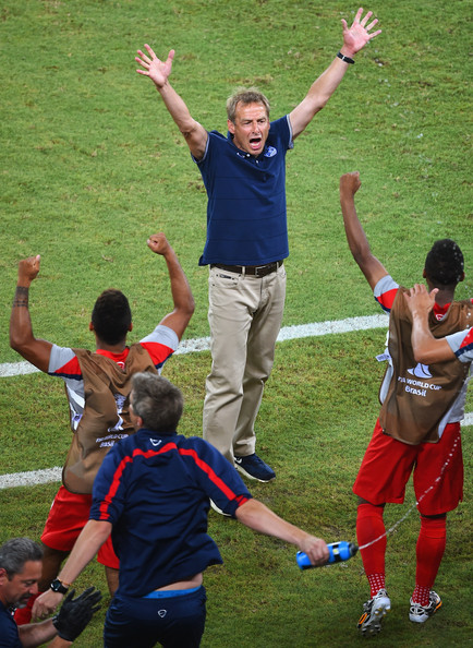 USMNT coach Jurgen Klinsmann celebrates against Ghana.