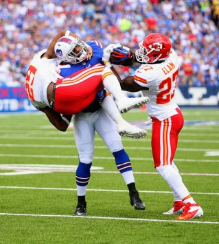 Dorin Dickerson #42 of the Buffalo Bills is tackled by  Eric Berry #29 and  Abram Elam #27 of the Kansas City Chiefs at Ralph Wilson Stadium on September 16, 2012 in Orchard Park, New York. Buffalo won 35-17.