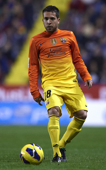 Jordi Alba of Barcelona runs with the ball during the la Liga match between Levante UD and FC Barcelona at Ciutat de Valencia on November 25, 2012 in Valencia, Spain.