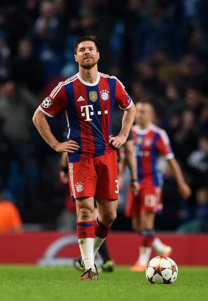 A dejected Xabi Alonso of Bayern Muenchen looks on following his team's 3-2 defeat during the UEFA Champions League Group E match between Manchester City and FC Bayern Muenchen at the Ethad Stadium on November 25, 2014 in Manchester, United Kingdom.