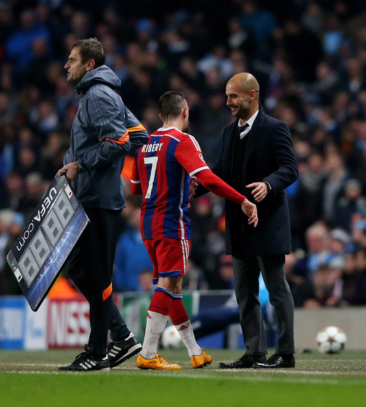 Josep Guardiola the head coach of Bayern Muenchen congratulates Franck Ribery of Bayern Muenchen as he is substituted during the UEFA Champions League Group E match between Manchester City and FC Bayern Muenchen at the Etihad Stadium on November 25, 2014 in Manchester, United Kingdom.