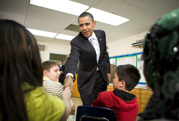 "(AFP OUT) U.S. President Barack Obama visits with sixth grade students at the Graham Road Elementary School January 19, 2010 in Falls Church, Virginia. Following his meeting with students the President will deliver remarks on his ""Race to the Top"" program and his request for an additional $1.35 billion in 2011 for the program."