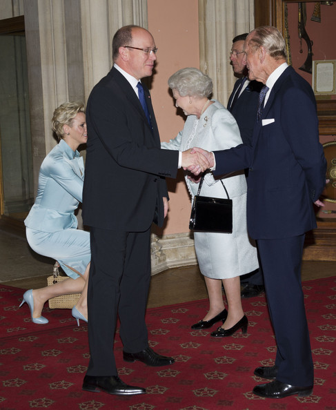 Queen Elizabeth II and Prince Philip, Duke of Edinburgh greet  Princess Charlene of Monaco and Prince Albert II of Monaco as they arrive at a lunch for Sovereign Monarch's held in honour of Queen Elizabeth II's Diamond Jubilee, at Windsor Castle, on May 18, 2012 in Windsor, England.