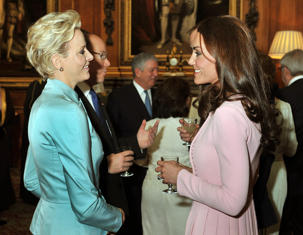 Catherine, Duchess of Cambridge talks to Princess Charlene of Monaco during a reception in the Waterloo Chamber, before the Lunch For Sovereign Monarchs at Windsor Castle, on May 18, 2012 in Windsor, England.